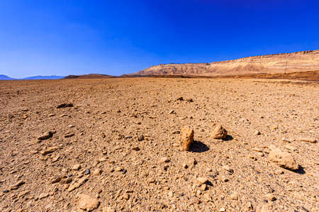 Breathtaking landscape of the rock formations in the Israel desert. Lifeless and desolate scene as a concept of loneliness, hopelessness and depression.