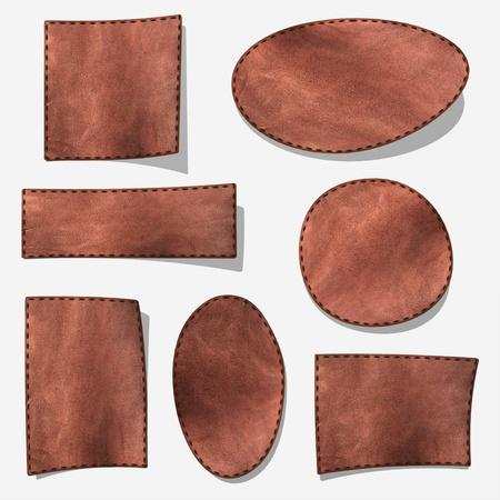 etiquetas de ropa: Etiqueta de cuero marr�n - aislado en gris con sombra  Foto de archivo