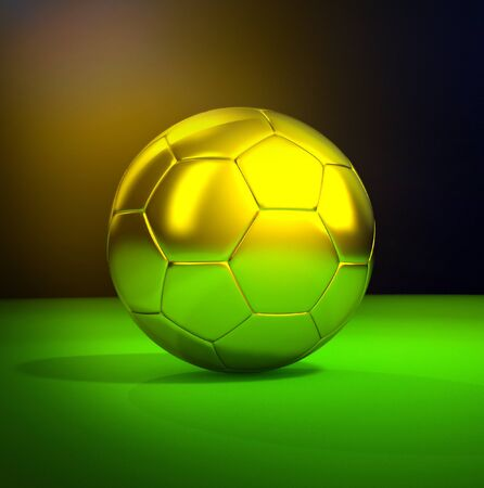 Gold soccer ball on the green field  photo