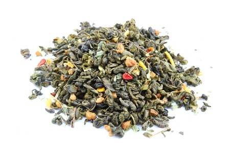 Dried green tea leaves with slices of strawberry and citrus  Stock Photo