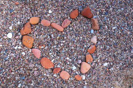 Heart lined with red stones photo