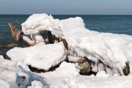 groyne: Winter beach of Baltic sea. Kaliningrad region. Russia Stock Photo