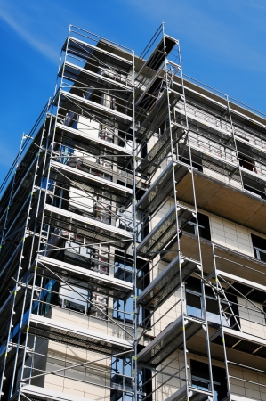buildingsite: Scaffolding construction with blue sky