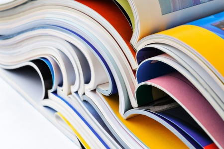 Pile of colorful magazines photo