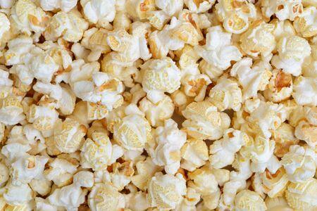 eating popcorn: Popcorn close-up on whole background