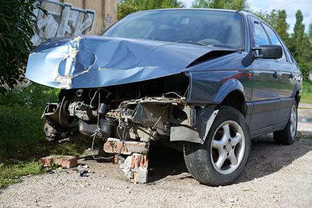 totaled: A blue wrecked car Stock Photo