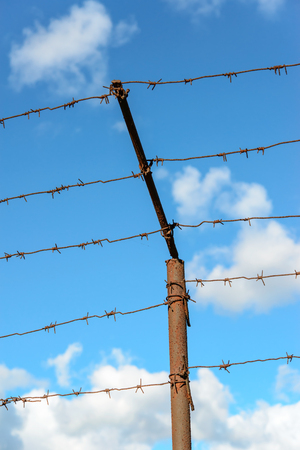 Barbed wire against blue sky  photo