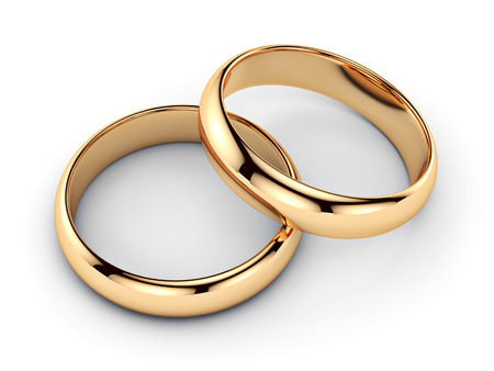wedding accessories: Pair of golden rings - isolated on white background  Stock Photo