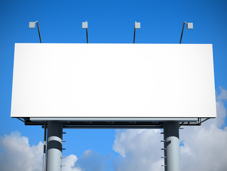 Billboard with empty screen, against blue sky  写真素材