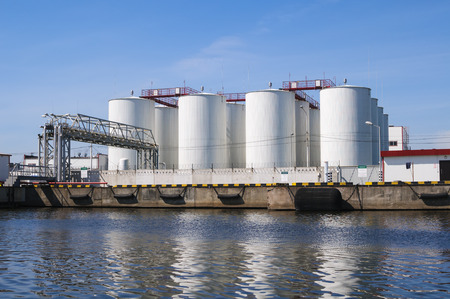 petrochemicals: White tanks for petrol and oil in industrial zone