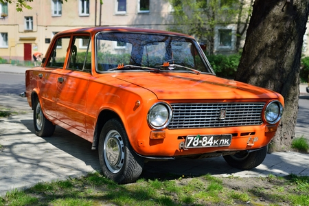 ransack: KALININGRAD, RUSSIA - APRIL 23, 2014  Aged soviet motor car VAZ 2101 Zhiguli at the city street