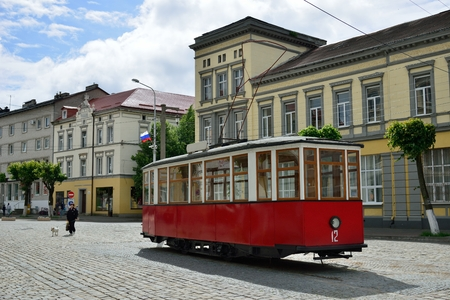 existed: SOVETSK, RUSSIA - JUNE 12, 2014  The monument Tilzit tram - installed on the Central square of Sovetsk, line Tilzit electric tram existed in the city since July 26, 1901 until October 1944
