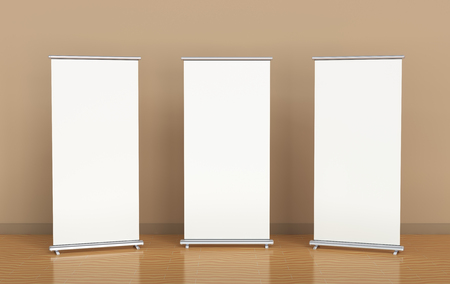 blank banner: Blank roll-up banners against the brown wall