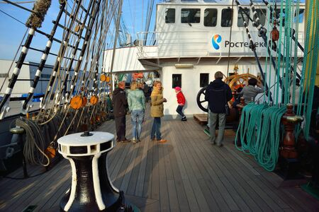 ship deck: KALININGRAD, RUSSIA - OCTOBER 5, 2014: Excursion for all comers at the famous Russian tall ship Kruzenshtern ex Padua, in the Fishing port.