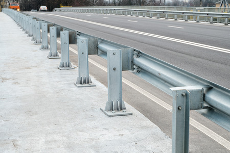 Safety barrier on freeway bridge