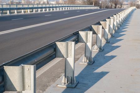 guard rail: Safety barrier on freeway bridge