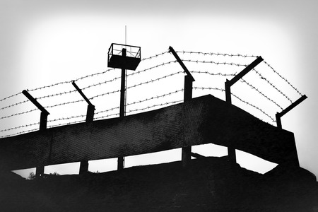 barbed wire fence: Prison fence with barbed wire, black and white grunge version