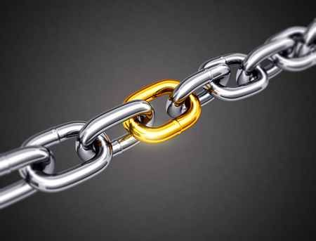 Steel chain with a gold link Standard-Bild