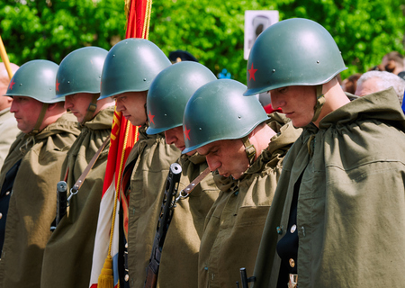 wwii: BALTIYSK, RUSSIA - MAY 9, 2015: Celebrating the 70th anniversary of the Victory Day (WWII), Soviet soldiers in helmets and cloaks