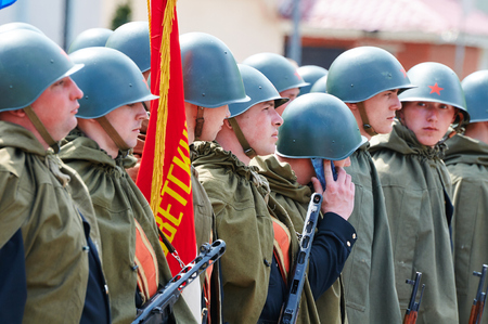 wwii: BALTIYSK RUSSIA MAY September 2015: Celebrating the 70th anniversary of the Victory Day WWII Soviet soldiers in helmets and cloaks