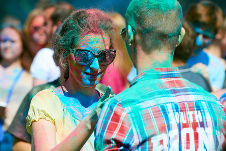holiday tradition: KALININGRAD, RUSSIA - JUNE 12, 2015: Unidentified girl during Holi Festival of Colors, the event is timed to the Day of Russia.