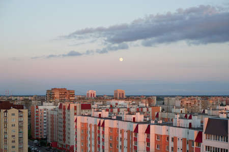 residential houses: Sunset over a residential apartment houses with moon