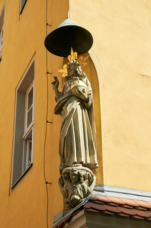 stary: POZNAN, POLAND - AUGUST 20, 2015: Stone statue of the Saint on the facade of the house, near the Old Market Square, Stary Rynek