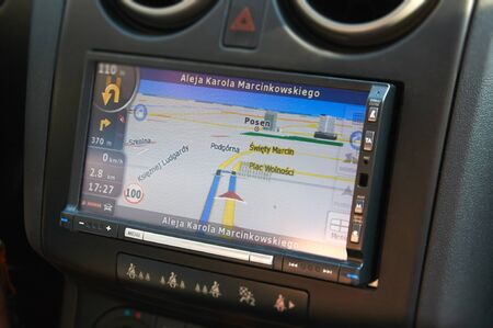 navegacion: POZNAN, POLAND - AUGUST 20, 2015: GPS navigation in interior of modern car, navigation on the streets of Poznan
