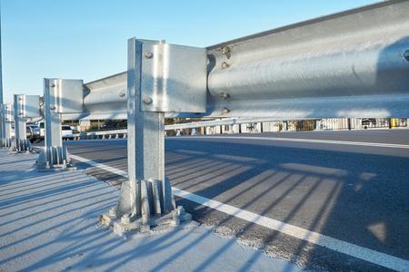 Anodized safety steel barrier on freeway bridge
