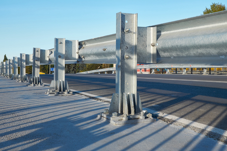 guard rail: Anodized safety steel barrier on freeway bridge