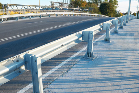 anodized: Anodized safety steel barrier on freeway bridge