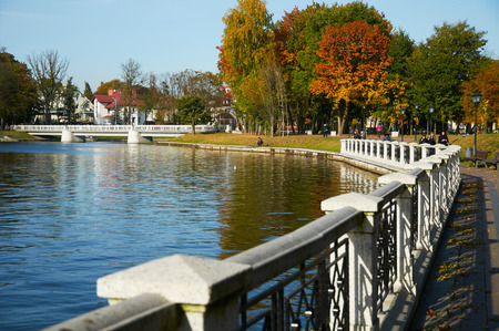 KALININGRAD, RUSSIA - OCT 15, 2015: People walking on a sunny autumn day on the banks of the Verkhnee lake Editorial