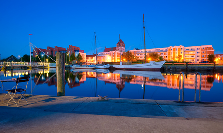 mecklenburg western pomerania: GREIFSWALD, GERMANY - MAY 25, 2016: Boat harbour on the river Ryck, yachts moored at the pier. West Pomerania