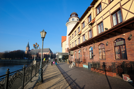 KALININGRAD, RUSSIA - DECEMBER 22, 2016: Ethnographic and trade center, embankment of the Fishing Village.