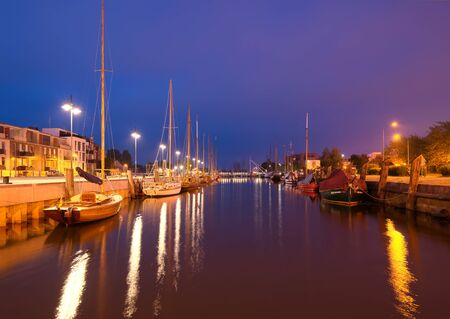 GREIFSWALD, GERMANY - MAY 25, 2016: Boat harbour on the river Ryck, yachts moored at the pier. West Pomerania