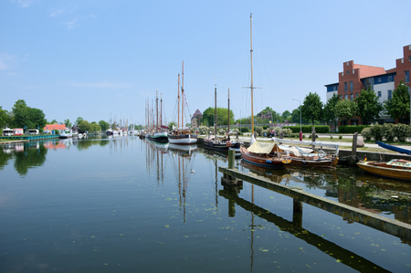 GREIFSWALD, GERMANY - MAY 24, 2016: Boat harbour on the river Ryck, yachts moored at the pier. West Pomerania