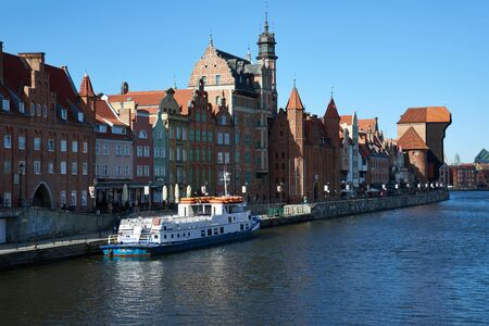 GDANSK, POLAND - APRIL 6, 2017: View of the riverside in Old Town by the Motlawa river, Gdansk is located in northern Poland and is very popular tourists destination Editorial