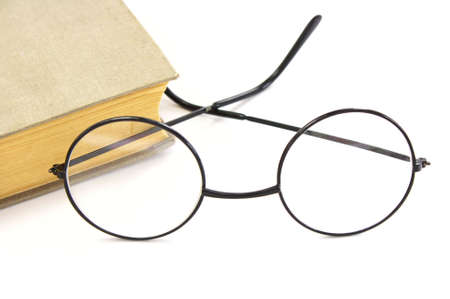 myopic: Book and glasses on a white background Stock Photo