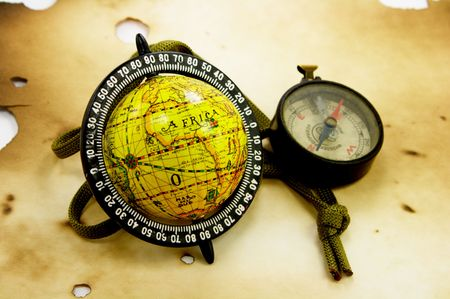 Globe and compass on old paper photo
