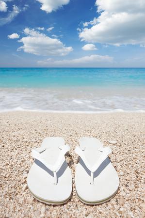 breeze: White flip flops on sea beach