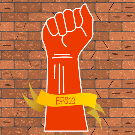 Vector illustration of a red hand clenched into a fist and a yellow ribbon with an inscription EPS10, on a brown brick wall background