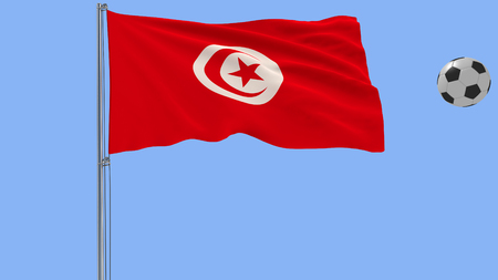 Realistic fluttering flag of Tunisia and soccer ball flying around on a blue background, 3d rendering