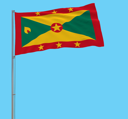 Isolate large cloth of Grenada on a flagpole fluttering in the wind on a blue background, 3d rendering Stock Photo