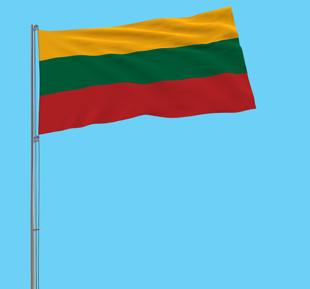 solate large cloth of Lithuania on a flagpole fluttering in the wind on a blue background, 3d rendering Stock Photo