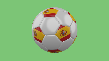 Soccer ball with Spain flag isolate on a green background, 3D rendering 스톡 콘텐츠