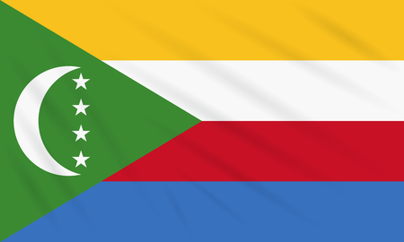 Flag Comoros swaying in wind, realistic vector.
