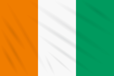 Flag Cote d'Ivoire - Ivory Coast swaying in wind, realistic vector. Иллюстрация