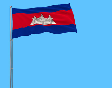 Isolate flag of Cambodia on a flagpole fluttering in the wind on a blue background, 3d rendering