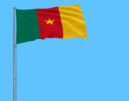 Flag of Cameroon on the flagpole fluttering in the wind on a pure blue background, 3d rendering