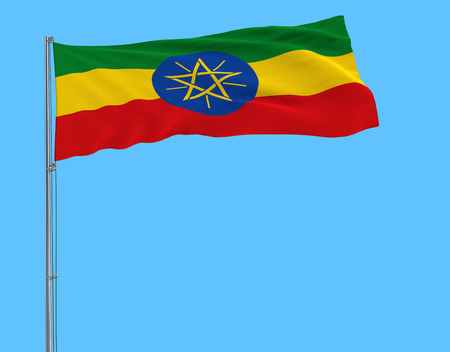 Flag of Ethiopia on the flagpole fluttering in the wind on a transparent pure blue background, 3d rendering
